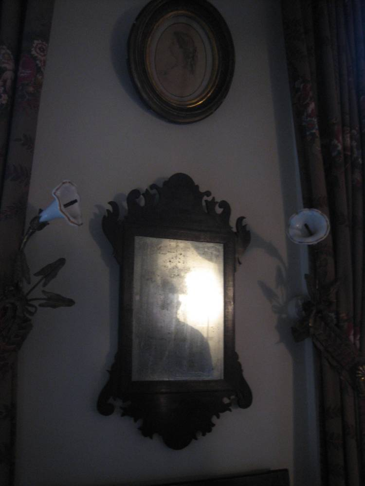 Sturges Paranormal captures a shadowy reflection in a mirror.