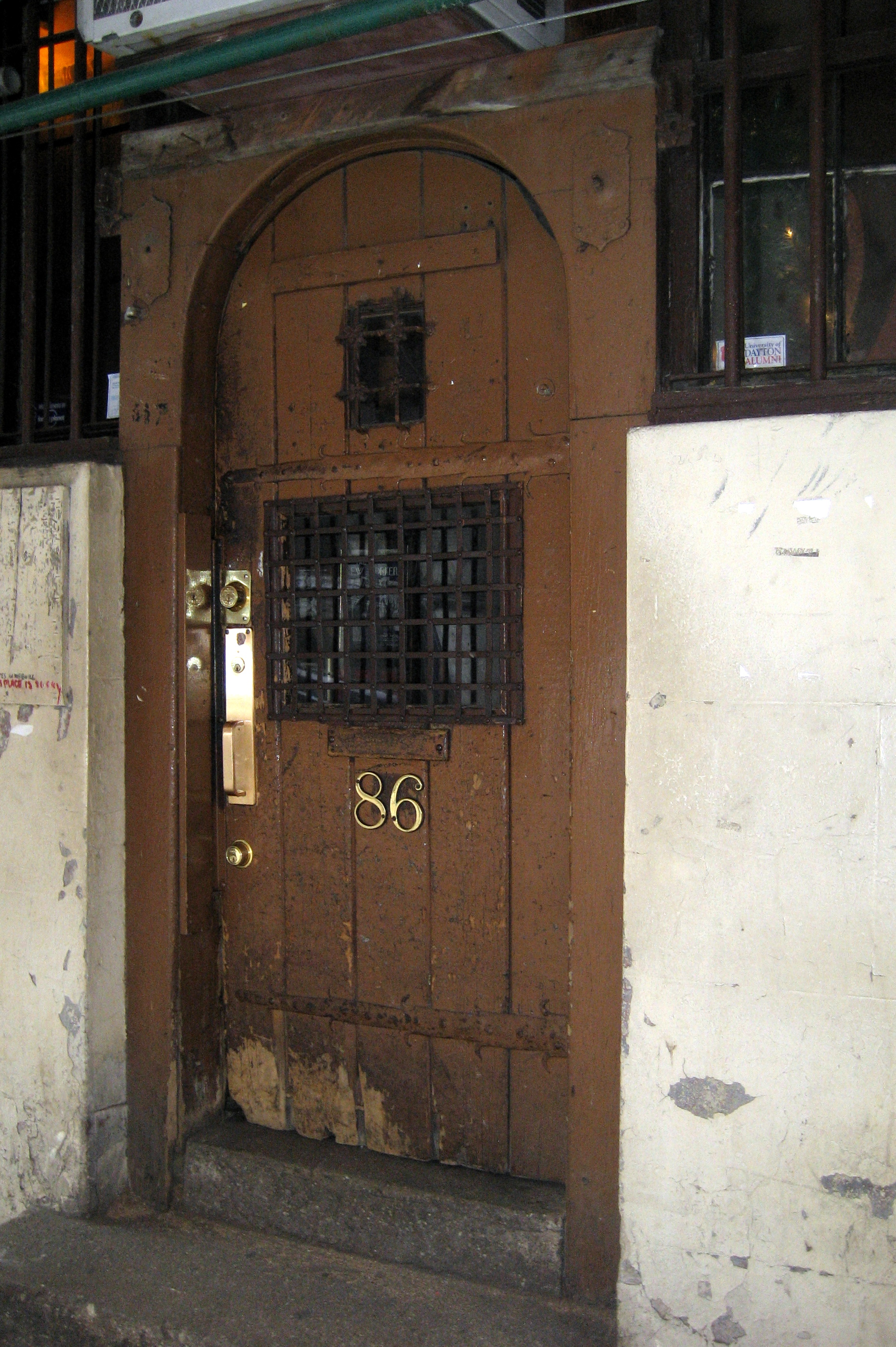 """The door to Chumley's, unmarked besides """"86."""""""