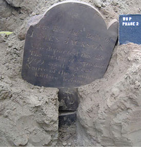 The unearthed headstone of James Jackson.