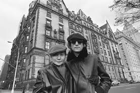 John Lennon and Yoko Ono outside of The Dakota.